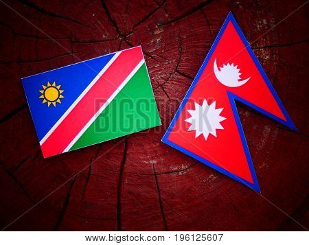 Namibian Flag With Nepali Flag On A Tree Stump Isolated