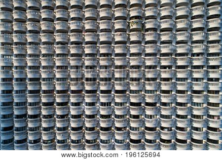 Background blurred .The rows of large white balconies of tall buildings. Window condo Design of porches Urban block house white
