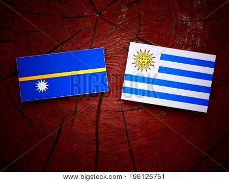 Nauru Flag With Uruguaian Flag On A Tree Stump Isolated