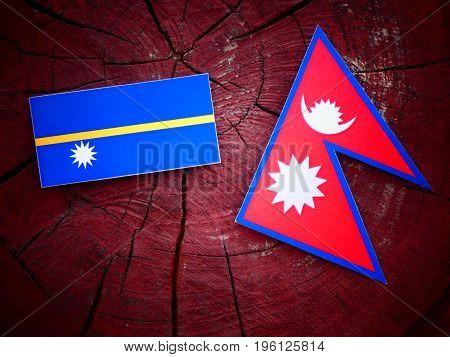 Nauru Flag With Nepali Flag On A Tree Stump Isolated