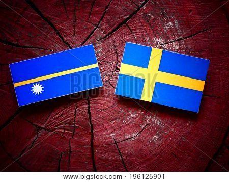 Nauru Flag With Swedish Flag On A Tree Stump Isolated