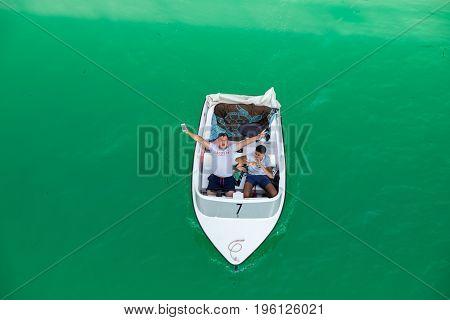 SAINTE-CROIX LAKE FRANCE - JUNE 20 2017: Two young guys on boat at Lac (Lake) de Sainte-Croix (Sainte-Croix-du-Verdon) Alpes-de-Haute-Provence France