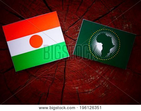 Niger Flag With African Union Flag On A Tree Stump Isolated