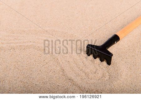 Clean Sand And Rake Garden Tools