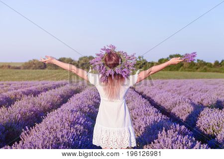Young happy beautiful girl in lavender field with