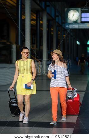 Young women with tickets and Luggage. Railway station.