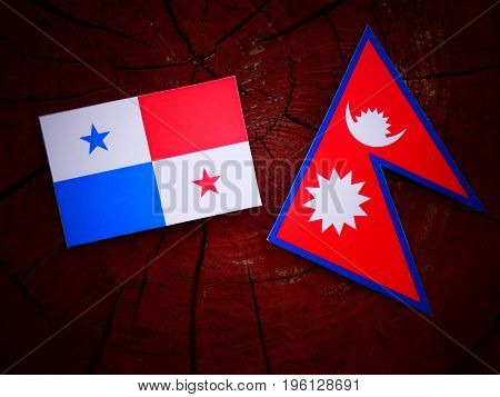 Panamanian Flag With Nepali Flag On A Tree Stump Isolated