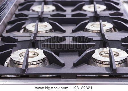 Kitchen burning gas cooker ; modern kitchenware;selective focus