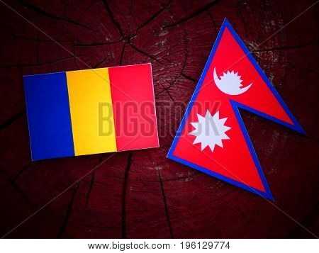 Romanian Flag With Nepali Flag On A Tree Stump Isolated