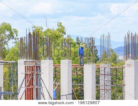 construction laborer team working on high ground building housing in site workplace