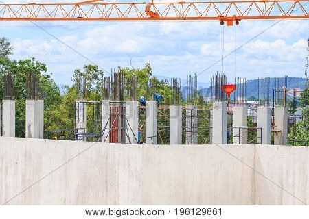 construction laborer team working and crane on high ground building housing in site workplace