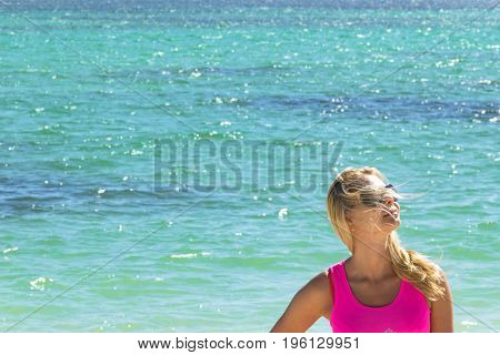 beautiful sexy young woman by the ocean