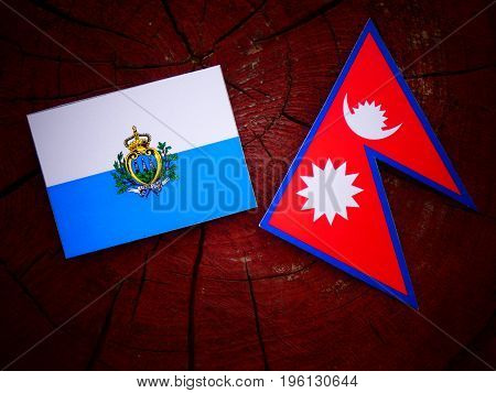 San Marino Flag With Nepali Flag On A Tree Stump Isolated