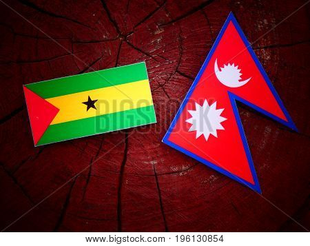 Sao Tome And Principe Flag With Nepali Flag On A Tree Stump Isolated