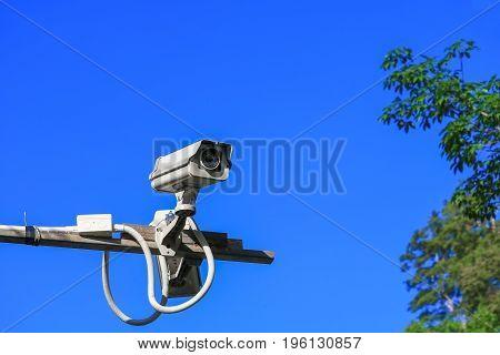cctv camera on blue sky background .