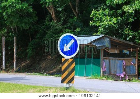 road sign traffic with arrows turn left on fork