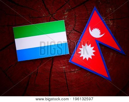 Sierra Leone Flag With Nepali Flag On A Tree Stump Isolated