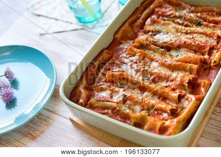 Close up of cannelloni stuffed with spinach and ricotta