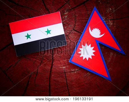 Syrian Flag With Nepali Flag On A Tree Stump Isolated