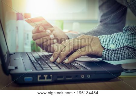 Businessman Using Laptop To Online Payment By Credit Card.