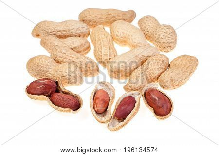 A pile of peanuts in the shell with few half opened nuts isolated on white background