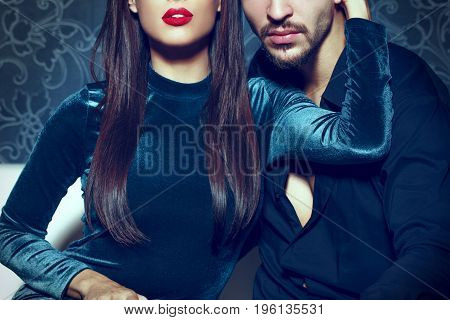 Sexy woman with red lips embrace young rich man seduction