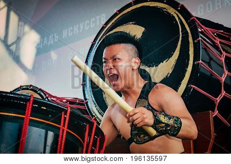 Moscow Russia - July 16 2017: Musicians ASKA-GUMI play the taiko drums on scene During the japanese festival.