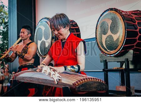 Moscow Russia - July 16 2017: Musicians ASKA-GUMI play the taiko drums shakuhachi and koto on scene during the japanese festival.