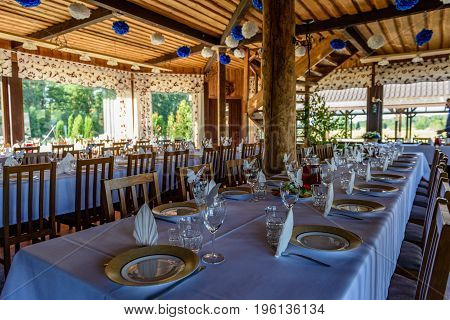 Beautifully Organized Event - Served Festive White Tables Ready For Guests. Event In Restaurant.