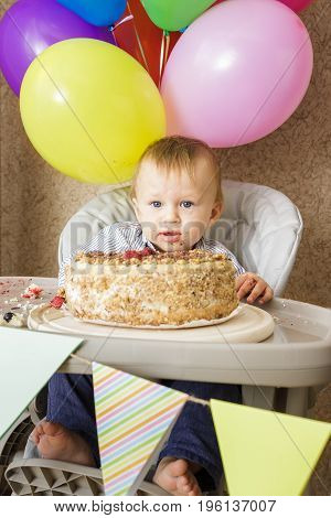One Year Old Boy Celebrating His First Birthday
