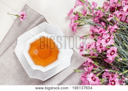 Cup Of Green Tea On White Table