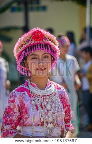 CHIANGMAI THAILAND - JANUARY 25 2015: Hill tribe girl with local traditional costume in parade of 22nd Traditional Skirt Fabric and The Indigenous Product and Culture Festival in Mae Chaem Chiangmai Thailand