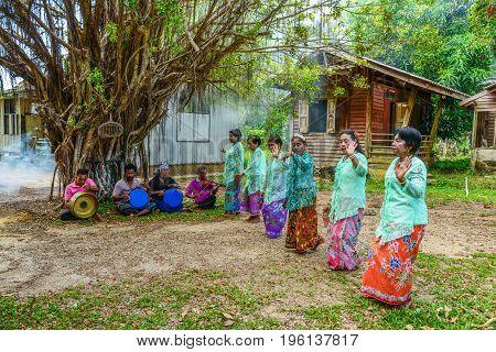 KRABI THAILAND - MAY 3 2015: Senior women doing Ronggeng dance while senior men palying music in Lanta island of Krabi Thailand