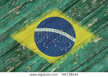 Flag of Brazil on an old wooden background