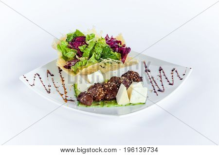 The rack of saucy barbecue pork served on white plate in restaurant