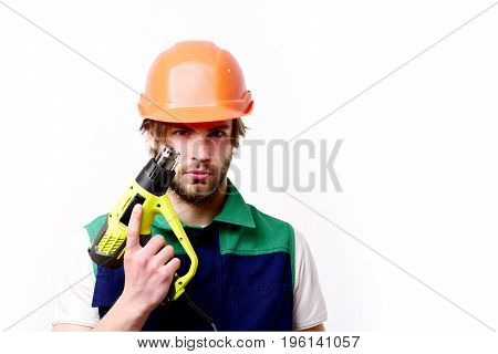Building and finished work concept. Man with beard and serious face expression isolated on white background. Repair worker holds yellow construction tool. Builder in orange helmet and uniform