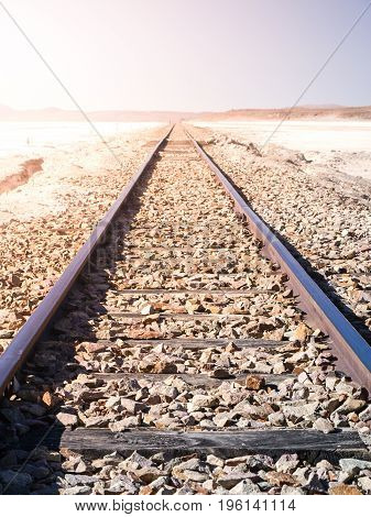 Railroad track in dry salt plains of Altiplano, Bolivia, South America.