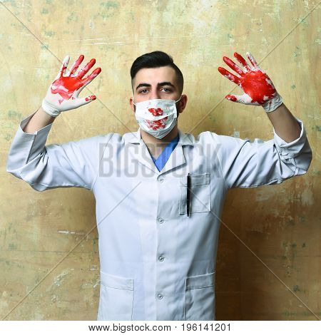 Doctor In Latex Gloves With Hands Up. Ambulance Services Concept