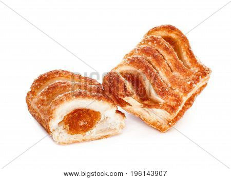 Delicious sweet puff pastry with fruit jam on white background