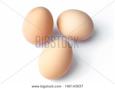 The Raw brown eggs isolated on white
