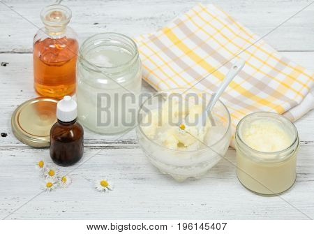 Making body scrub for clear soft skin. Made from granulated sugar bamboo butter coconut and sea buckthorn oil decorated with daisy