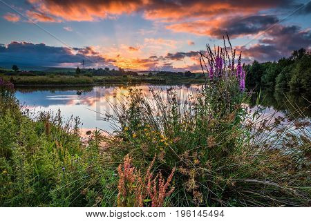 Sunset at Branton Lakes. Branton Lakes Nature Reserve was constructed from a former mineral quarry located at Branton in the Breamish Valley, Northumberland