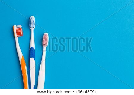 Colorful toothbrushes , space for text