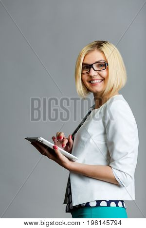 Beautiful smiling woman holding smartphone