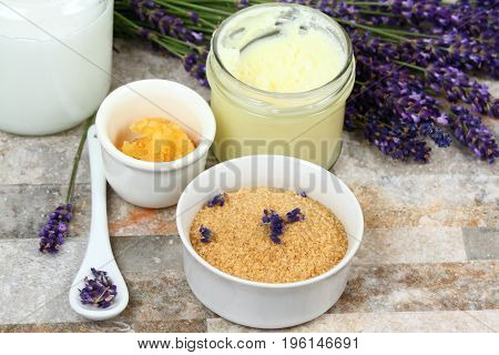 Making homemade body scrub for clear soft skin. Made from granulated sugar bamboo butter coconut oil and lavender flowers