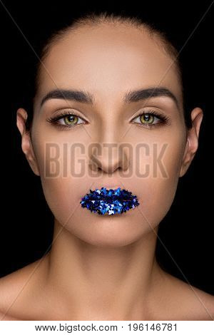 Gorgeous Fashionable Woman With Blue Sparkles On Lips, Isolated On Black