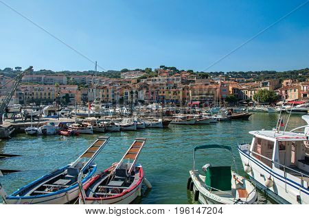 Cassis, France - July 09, 2016. View of boats and yachts moored in the city center of Cassis, a beautiful and sunny seaside town with harbor. Provence region, southeastern France