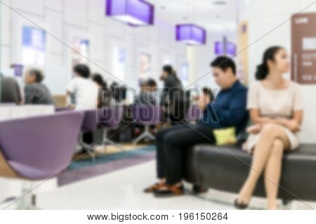 Blurry background of people waiting in financial transactions in the bank.