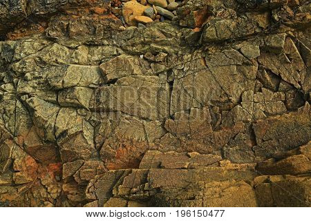 Texture of dark cracked rock as background