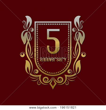 Fifth anniversary vintage logo symbol. Golden emblem with numbers on shield in wreath.